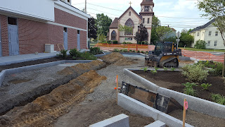work on the Horace Mann greenspace and location of the new statue makes progress