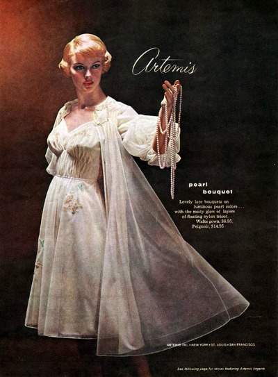 Advertisement for Artemis Lingerie 1959 featuring model in white peignoir set
