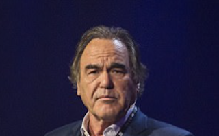 'Two of a kind!' Former Playboy Playmate accuses Oliver Stone of groping her breast after the film director defended Harvey Weinstein