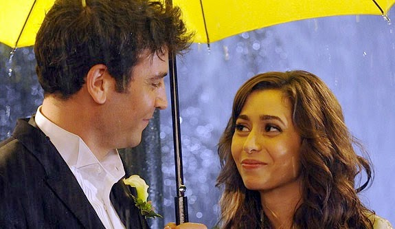 Josh Radnor as Ted Mosby smiling at Cristin Milioti as the Mother, Tracy McConnell, under a yellow umbrella