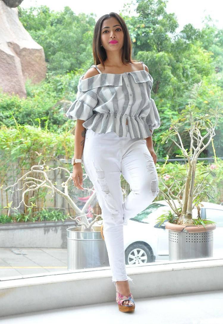 Shweta Basu Prasad Long Hair Stills In White Shirt Pant