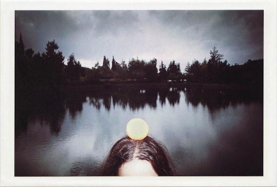 dirty photos - time - cretan landscape photo of orange on head in front of zaros lake