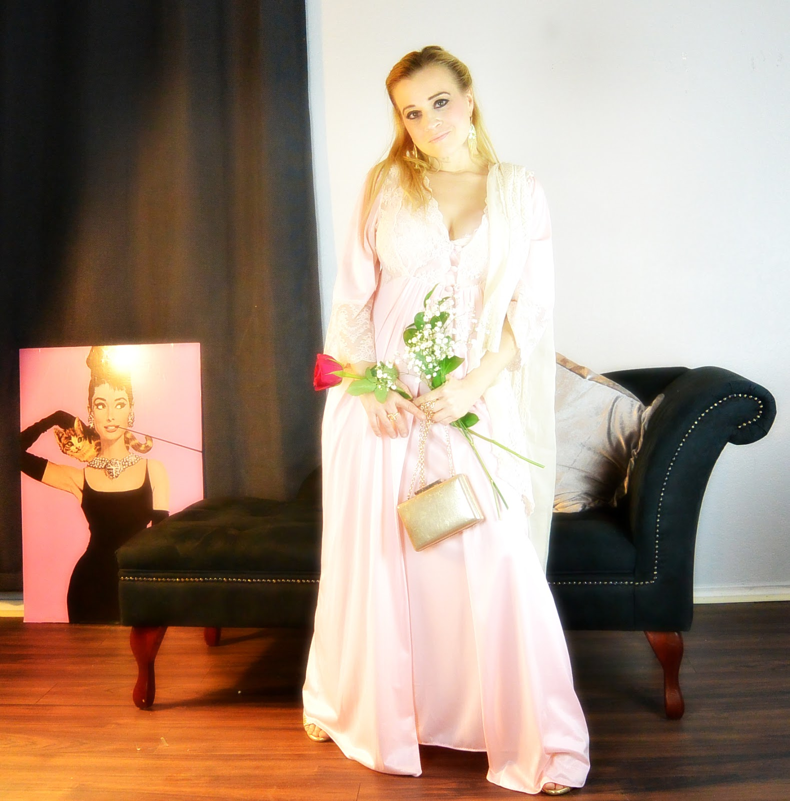 blonde modeling vintage nightgown while standing with rose