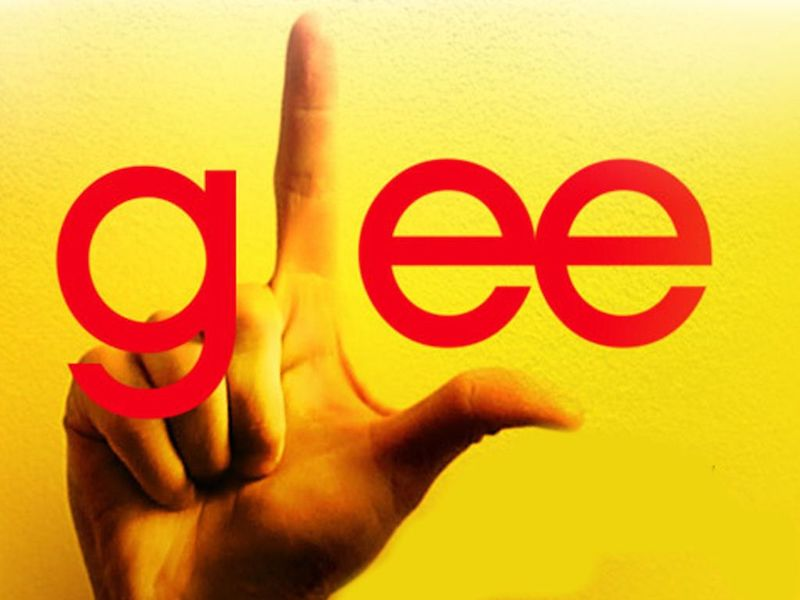 a person's right hand making an L shape to fit into the word 'glee'