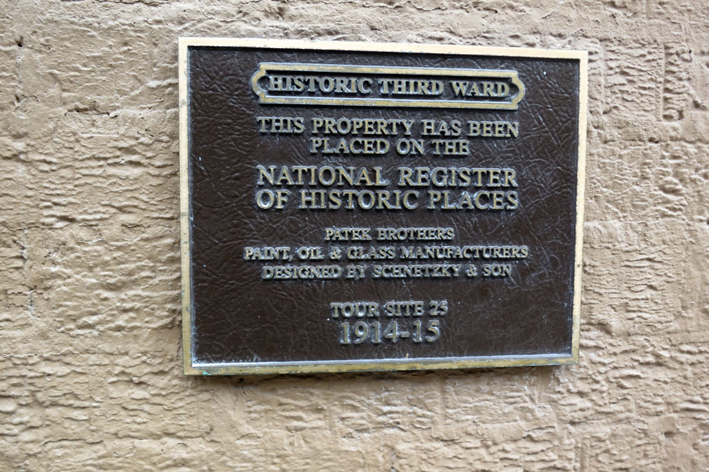 Historical marker on building.