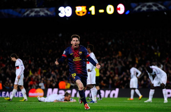 Barcelona forward Lionel Messi celebrates after scoring a goal against AC Milan