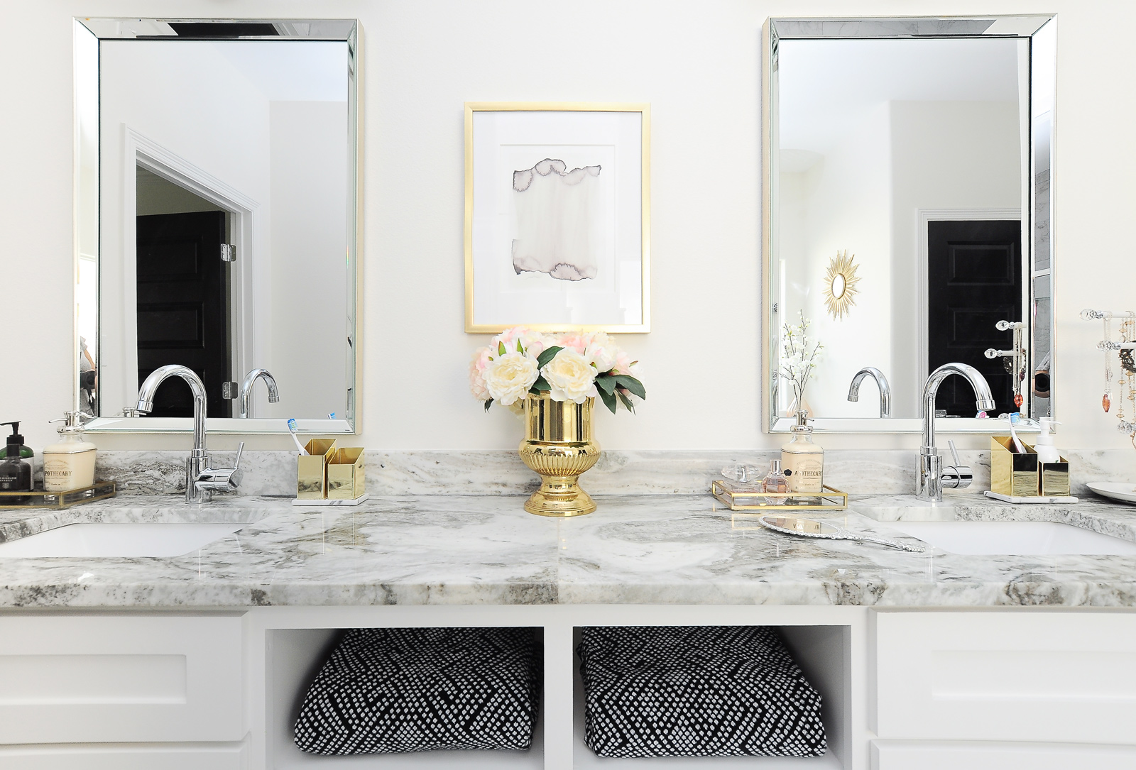 A gorgeous bright white and gold master bathroom with brass lucite cabinet hardware and a luxe hotel vibe. I'd love to get ready in this space!