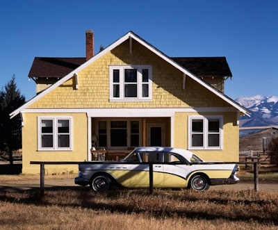 Yellow house and 1957 Buick