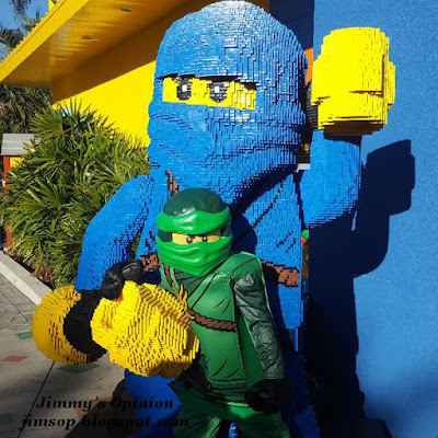 Benjamin dressed as Lego character Lloyd posing with a character made completely from Legos