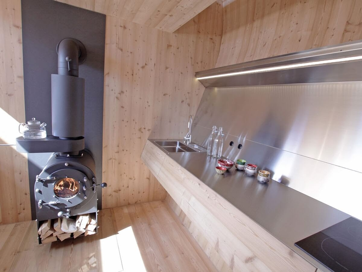 02-Kitchen-and-Wooden-Stove-Architecture-with-the-Ufogel-Tiny-House-www-designstack-co