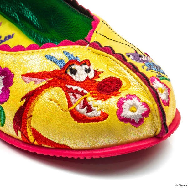 close up of side of kids shoe toe, with embroidered detail