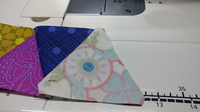 Sewing equilateral triangles