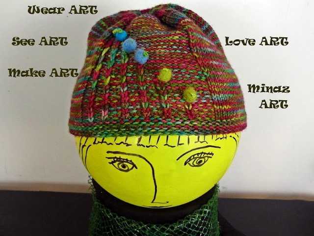 Multi-color Knit Purl Hat with Felted Ball designed by Minaz Jantz