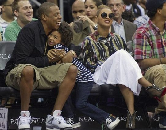 b7448ab66ab6f0 Here is new images of Jayz Rockin Air Jordan White Cement 4 Sneakers at the  New Jersey Nets Game With Beyonce. Peep The Full image after the jump.