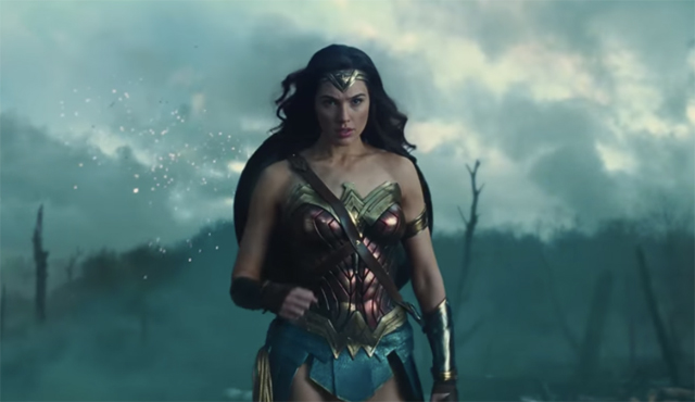 image of Gal Gadot as Wonder Woman, walking across a battle field looking tough as hell
