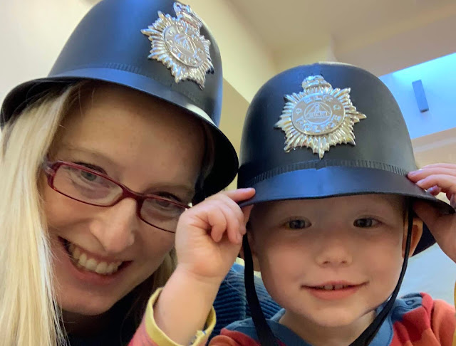 Me and a toddler wearing police hats and smiling