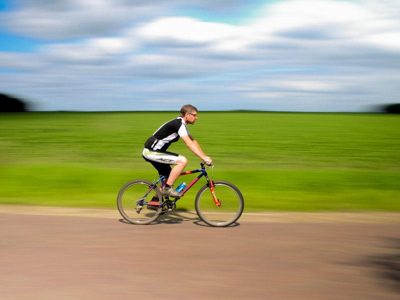 Download Blurred Bicyclist HD wallpaper. Click Visit page Button for More Images.