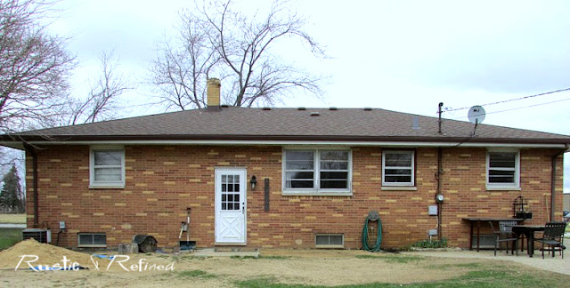 Brick ranch home before any landscaping installed - a garden plan