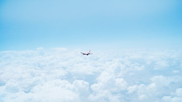 With Airplane Above the Clouds