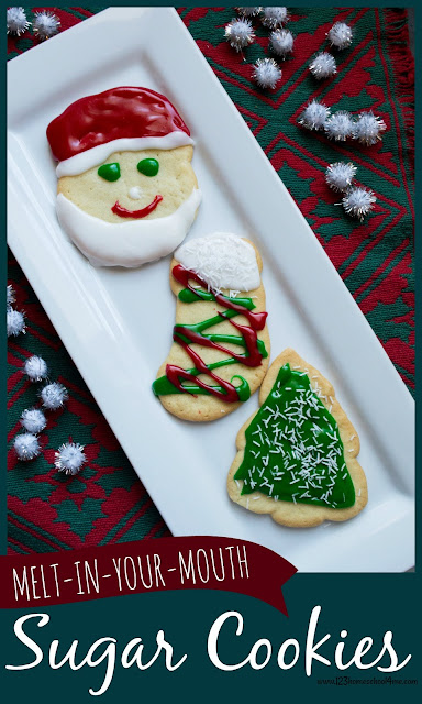 BEST Sugar Cookie Recipe - these sugar cookies AMAZING! They come put perfect every time and melt in your mouth! These are the perfect Christmas cookie, valentines day cookie, and everyday cut out cookie to bake with kids