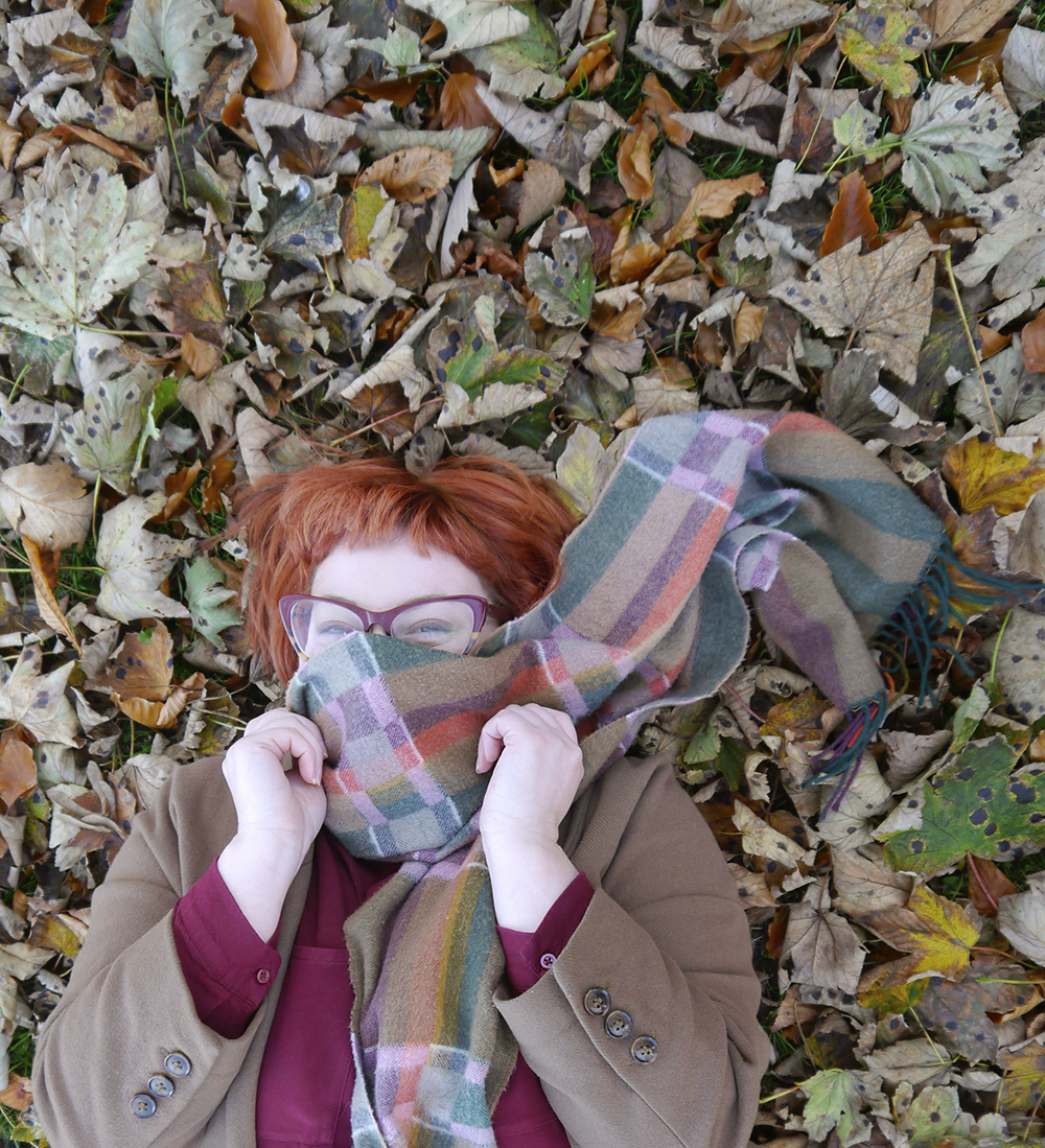 Wearing a vintage scarf in the leaves for an autumn outfit