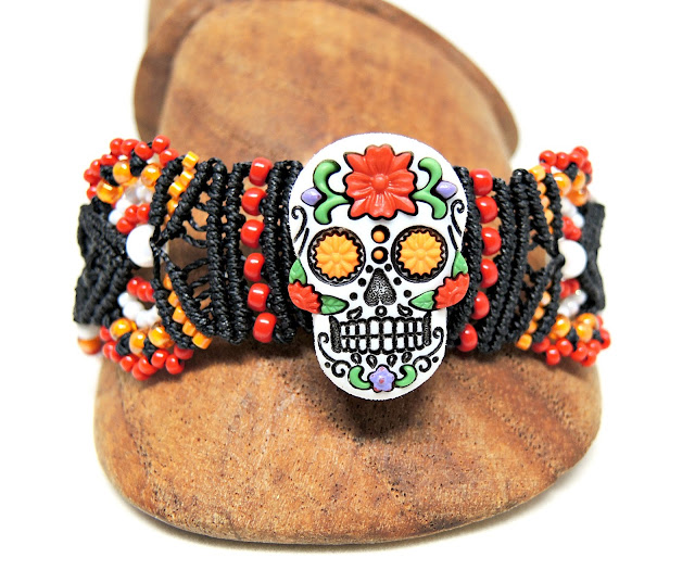 Day of the Dead Sugar Skull micro macrame bracelet in red and orange.