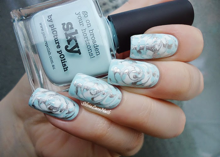Wintery dry marble spiral nail art