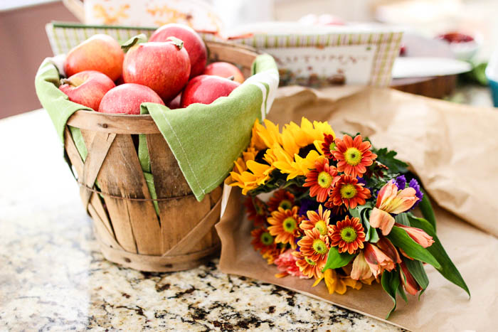 Fall flowers and apples in bushel basket - www.goldenboysandme.com