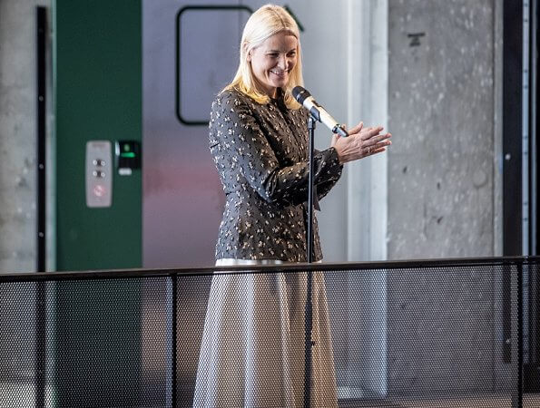 Crown Princess Mette-Marit wore a new silk wool jacket by Brock Collection, and pleated midi skirt. Deichman Library children's books
