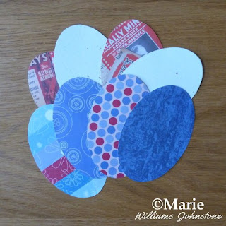 ovals of paper in reds whites and blues patterns colors card making scrapbooking