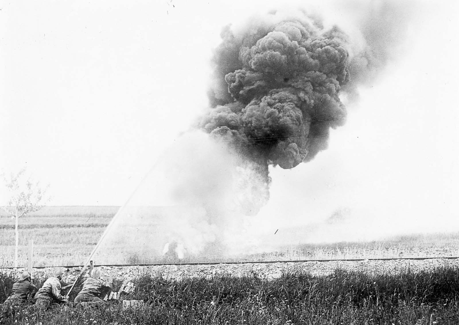 French forces use a flamethrower against German forces. 1915.