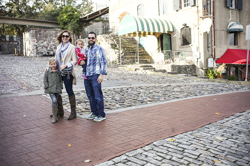 Amy West and family stand on Savannah's famous River Street.
