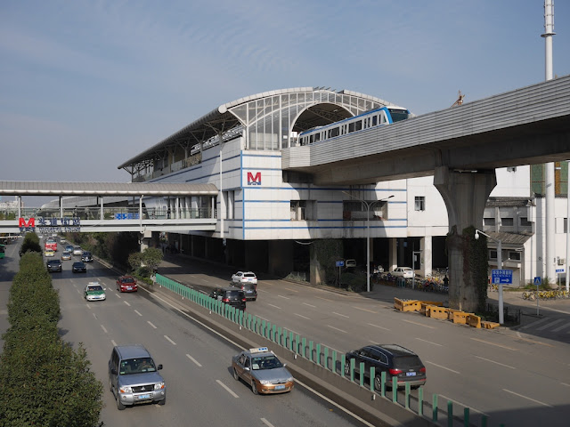 view of Toudao Street Station (头道街站) in Wuhan with a departing metro train