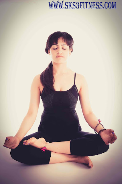 A women seating in Half Lotus Pose Ardha Padmasana Yoga Meditation Poses