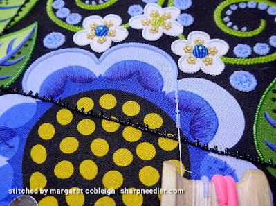 Using a beading koma to outline light blue petal with beads (Wild Child Japanese Bead Embroidery by Mary Alice Sinton)
