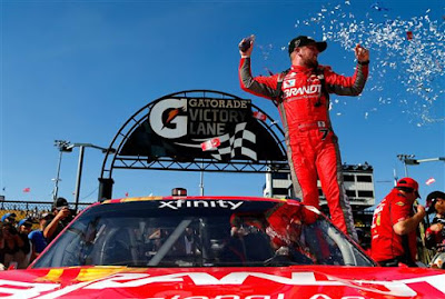 Justin Allgaier,celebrates in victory lane after winning the NASCAR XFINITY Series DC Solar 200 Sean Gardner/Getty Images