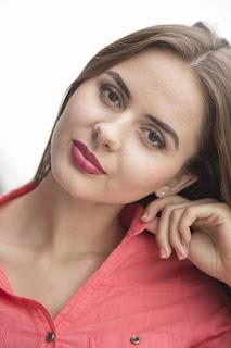 beautiful woman in red blouse.jpeg
