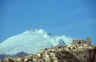 Motta Sant'Anastasia, with a snow-covered Mount  Etna in the background