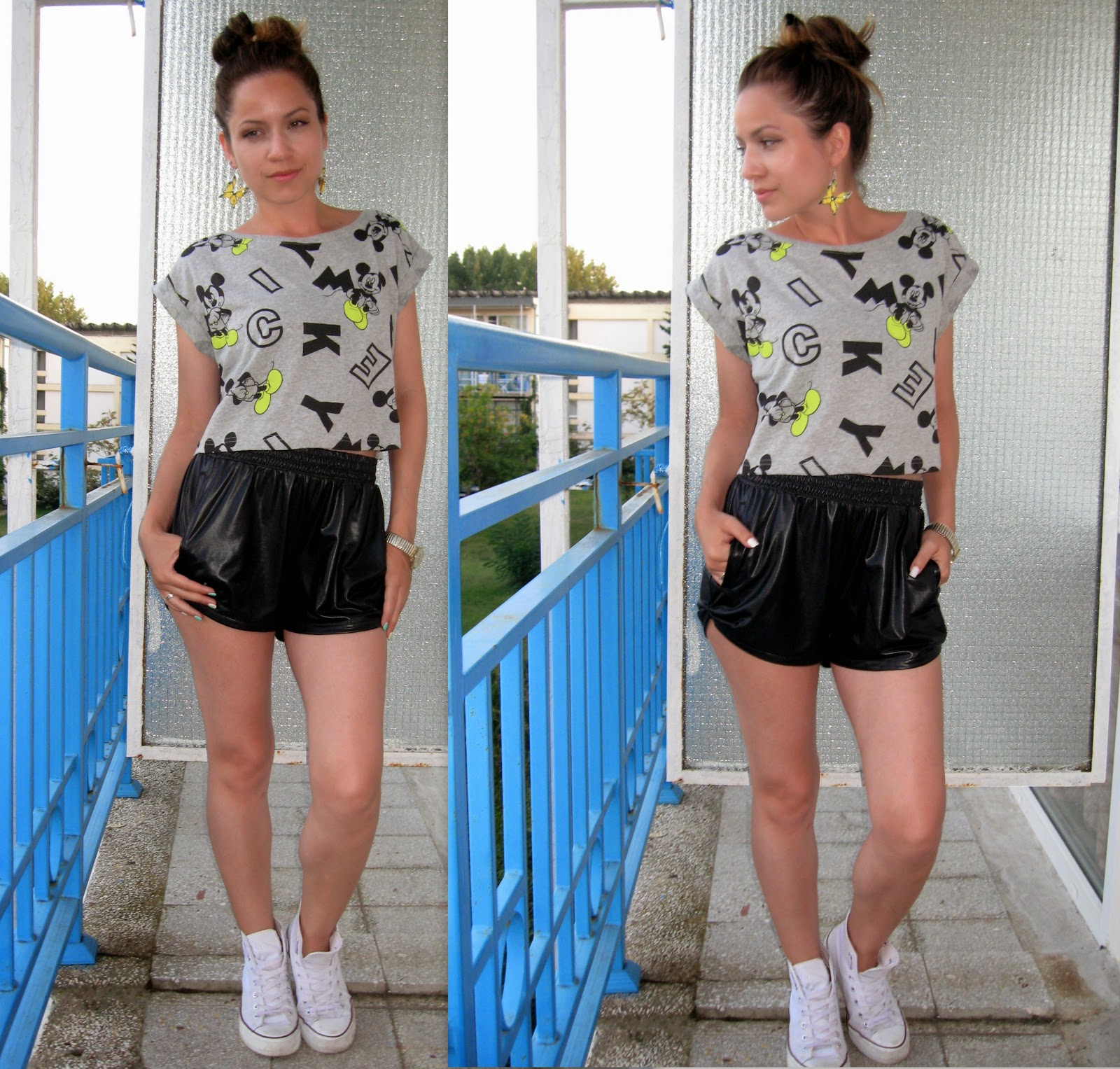 terranova grey mickey mouse print crop top, messy bun, black faux leather shorts, white converse, yellow butterflies earrings,