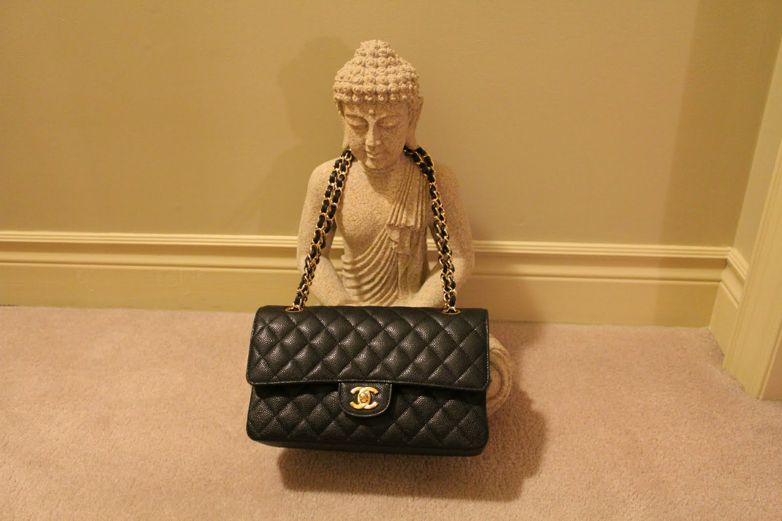 12929ffa5428 It's a small/medium double flap bag in caviar leather that was purchased  from the Chanel store at Saks Fifth Avenue.