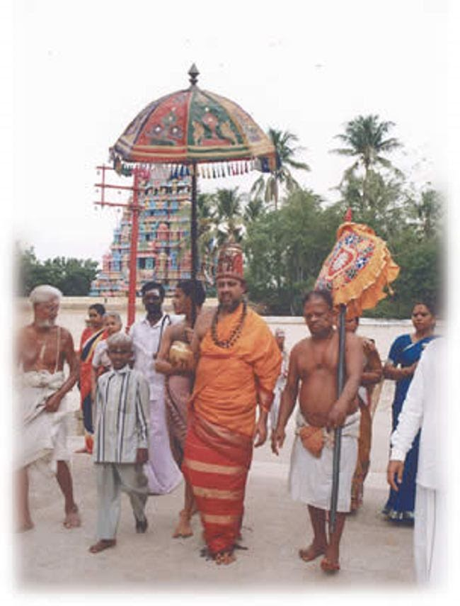 Temple Priest dressed like Devi Akilandeswari going in procession to perform Shiva Pooja
