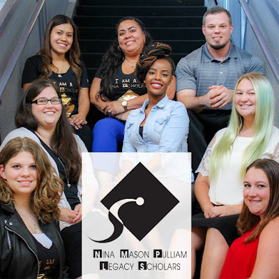 Photo of Nina scholars gathered near stairwell.  Poster for Nina Mason Pulliam Legacy Scholars and logo in front of them.