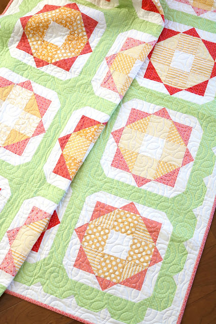 Sunny Day quilt pattern from the Fresh Fat Quarter Quilts book by Andy Knowlton of A Bright Corner - uses 12 fat quarters and has a fun scallop border