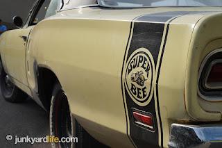 Quarter panel of 1969 Super Bee displays Rumble Bee logo.