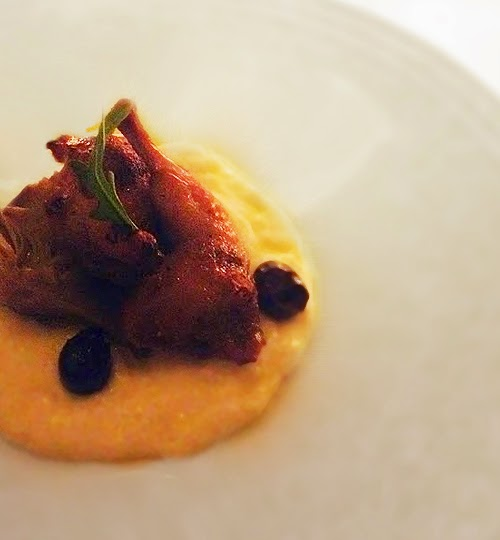 roasted tiny bird on polenta with olives