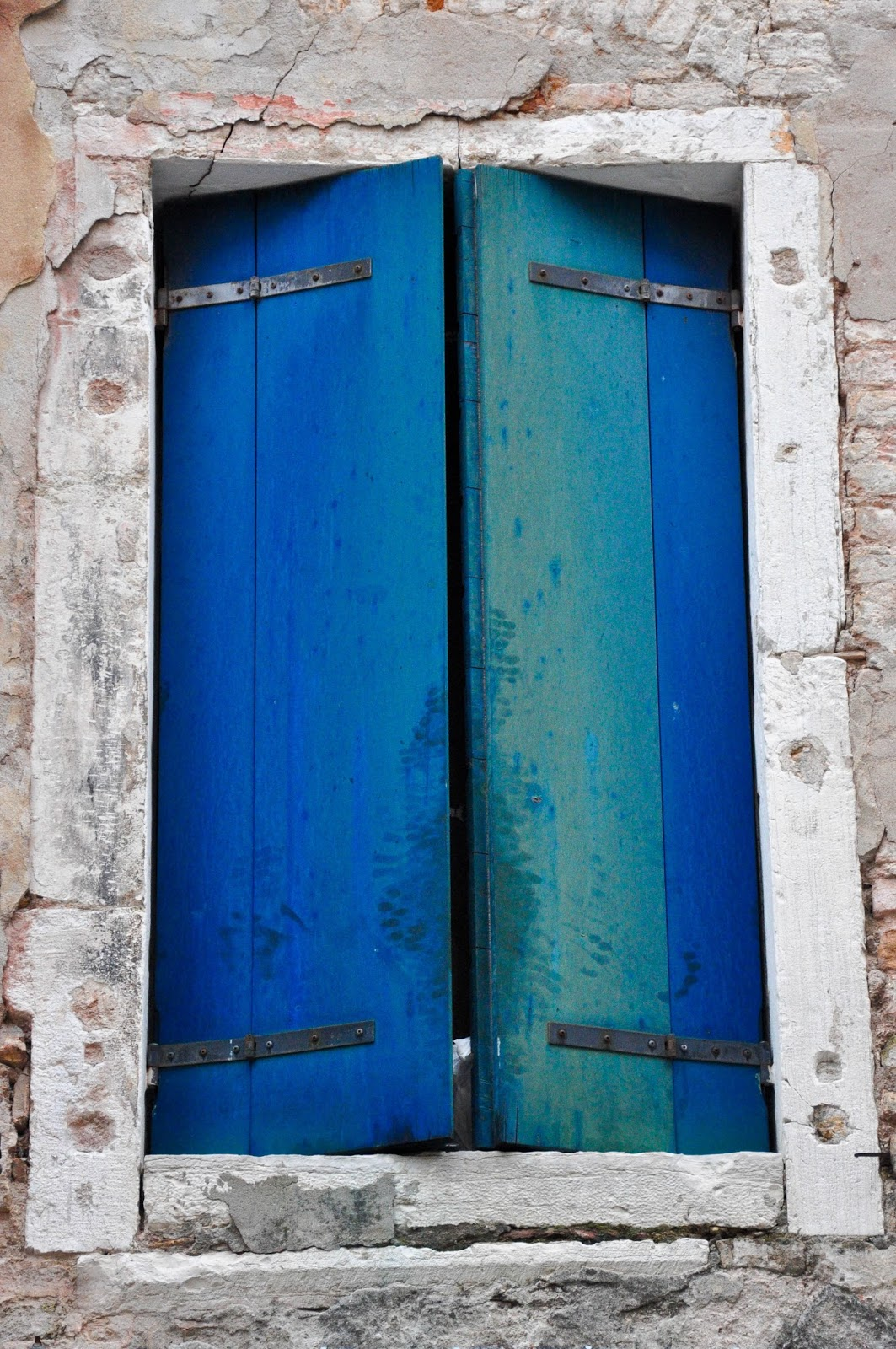 Faded blue shutters, Venice, Italy