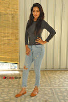 Actress Bhanu Tripathri Pos in Ripped Jeans at Iddari Madhya 18 Movie Pressmeet  0013.JPG