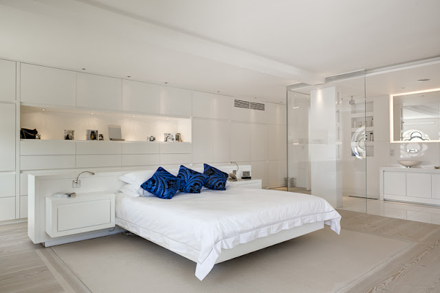 Picture of floating bed in the modern bedroom with white furniture