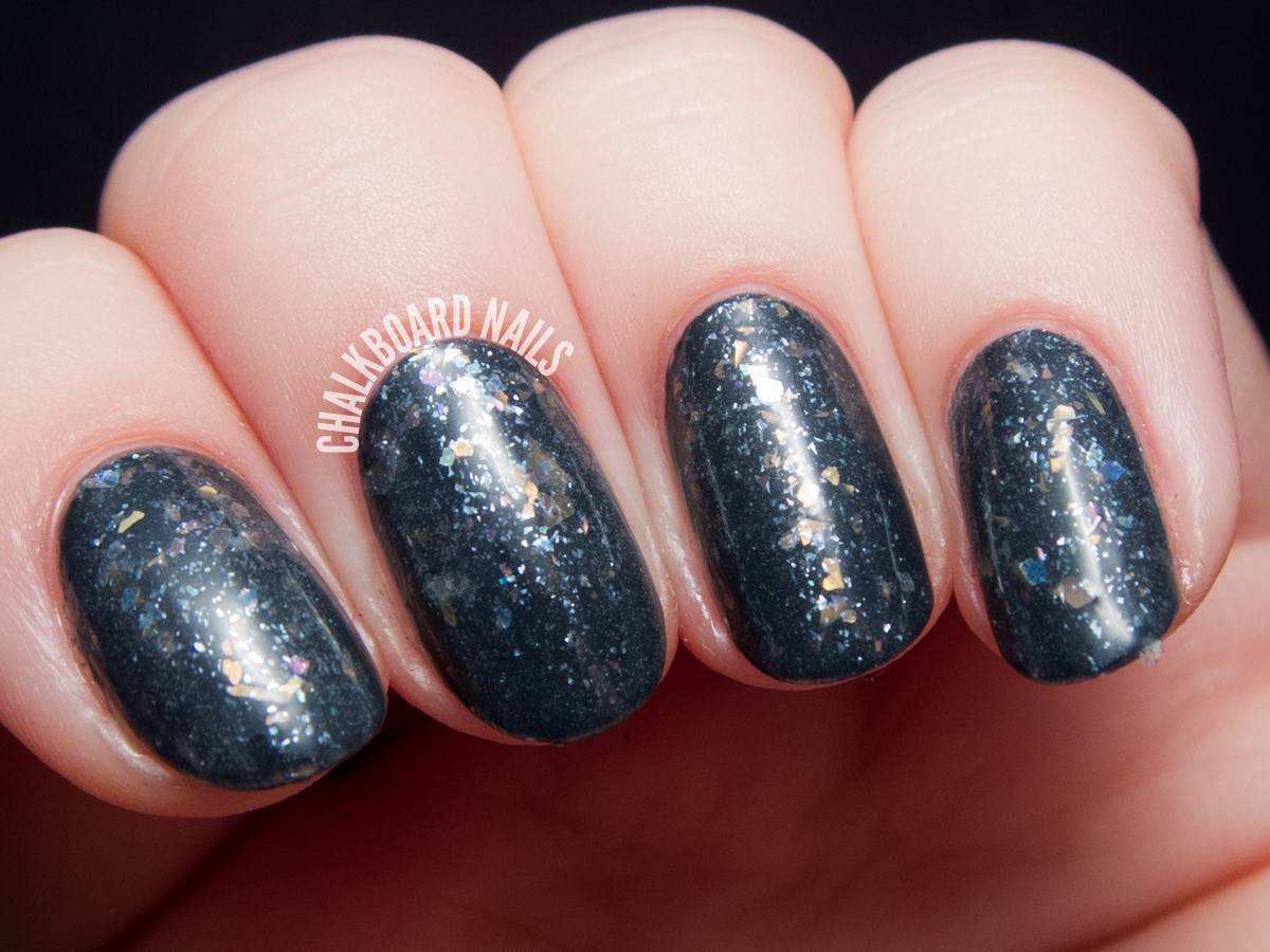 Serum No. 5 Fractured Rainbows over navy via @chalkboardnails
