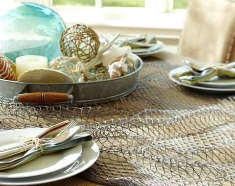 nautical tablescape with fish net Pottery Barn